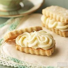 Make the vanilla-flavored shortbread in advance and store them in the freezer. Then when you're ready to present them, add the fresh orange frosting to make an elegant sandwich cookie.  /