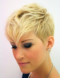 Pixie with shaved sides, long bangs. (If I could work this style, I would get it in a heartbeat)
