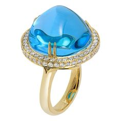 For Sale on - STYLE Blue Topaz Uneven Round Cabochon Ring in Yellow Gold with Diamonds, from 'Rock 'N Roll' Collection Stone Size: 19 mm Diamonds: G-H Blue Topaz Diamond, Blue Sapphire Rings, Blue Chalcedony, Diamond Drop Earrings, Cocktail Rings, Fashion Rings, Fine Jewelry, Jewellery, White Gold