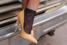 Studded mesh socks paired with a pair of high heels. Chic and unconventional.