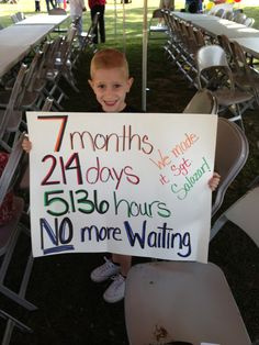 mom and son waiting for military daddy to come home from deployment