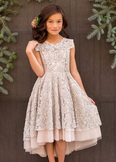 Let your fashionista be the belle of the ball in this gorgeous silver peony dress, featuring lovely lace and a soft layered tulle underlay. With a vintage inspired necklace and a skirt with volume, this dress is prefect for twirling.