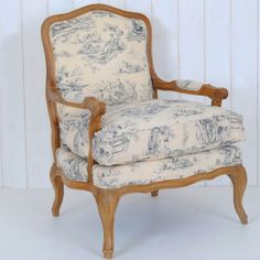 Bergere chair.  I have this identical chair and it is covered in black and white toile.  / MAG