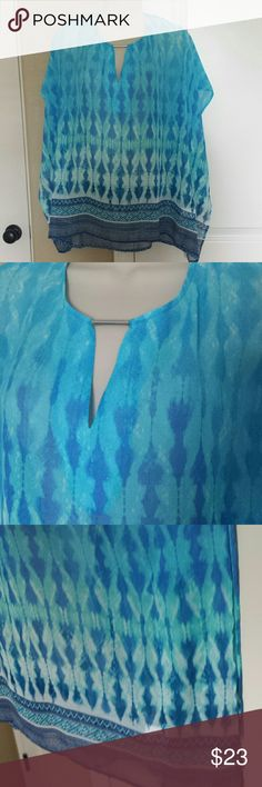 """JUST IN TURQUOISE Blouse Open sides, very light and comfy. Size L. Approx.26"""" long.and 23""""wide. Tops Tunics"""