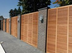 a look at our projects with sustainable wall coverings and exterior floors., Take a look at our projects with sustainable wall coverings and exterior floors. Yard Design, Fence Design, Design Cour, Home Fencing, Tropical Backyard, Privacy Walls, Modern Fence, Outdoor Living, Outdoor Decor