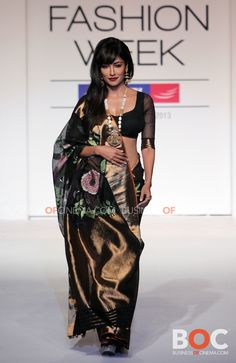 Gaurang Shah. LFW 2013 love the flowers on the black <3