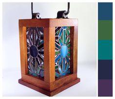 This open top, wooden frame lantern radiates warm glow of glittering colour in a gradient pattern that wraps around the lantern. Colours range