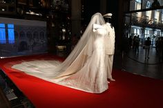 Princess Charlene of Monaco wedding dress and Prince Albert II of Monaco's costume are displayed during the exhibition 'L'Histoire du Mariage Princier' (History of the Prince's wedding) at the Musée Océanographique de Monaco, on July 11, 2011.