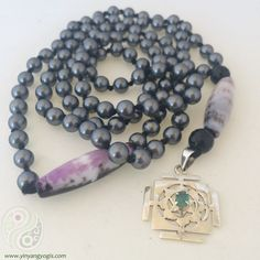 108 Grey Freshwater Pearls enhanced by a sterling silver & emerald yantra