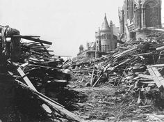 The Gresham house, center, now known as the Bishop's Palace, sits relatively unscathed behind a wall of debris following the hurricane that devastated Galveston, Texas, Sept. 8, 1900. More than 6,000 people were killed and 10,000 left homeless as entire neighborhoods were swept clean. Heavily damaged Sacred Heart Catholic Church is at right. (AP Photo/Sisters of Charity of the Incarnate Word)