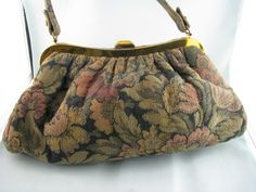 tapestry bag may be purchase $50.00 contact me through my web at  http://vintagecollector.ca/