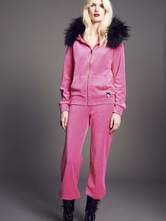 Model wears Naughty Dog chenille #cardigan with soft black fur hood and a pair of matching #trousers.