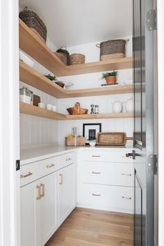 walk in pantry with white cabinets and light oak shelves Pantry Design, Kitchen Design, Country Wall Mirrors, Timber Shelves, Oak Shelves, Modern Style Homes, White Countertops, Farmhouse Kitchen Decor, Kitchen Interior