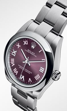 Rolex Oyster Perpetual 31mm in 904L steel with a domed bezel, red grape dial, roman-numeral hour markers  and an Oyster bracelet.