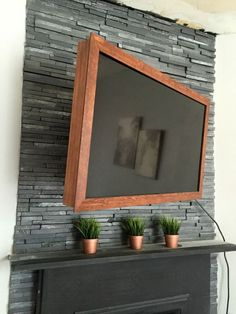 diy 40 wood tv frame works for tvs that tilt and rotate too, concrete masonry, diy, fireplaces mantels, home improvement, painting, woodworking projects