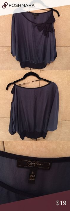 Jessica Simpson blue blouse size small Blue silky top with single cold shoulder and bow detail on shoulder. Banded bottom and very good condition. Material is designed to have a somewhat crinkly appearance as seen in the photos. Jessica Simpson Tops Blouses