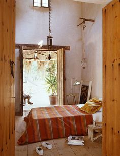 interior design Spanish style Moroccan bohemian exotic romantic whitewashed exposed beams tall ceilings
