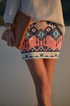 Tribal skirt. Satin or embellished black top instead of the sweater <3