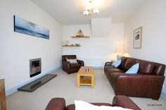 sandcastle cottage has a pebble and driftwood effect gas fire to make it easy to warm up after chilly walks by the sea.