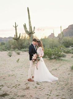 Desert wedding blue blazer groom
