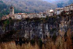Castellfollit de la Roca, Spain: a 1,000 person village perched on a spit of land with cliffs on both sides.