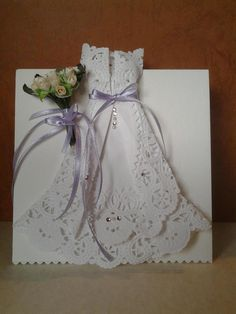 I made this origami wedding dress after I saw how other card makers made some.