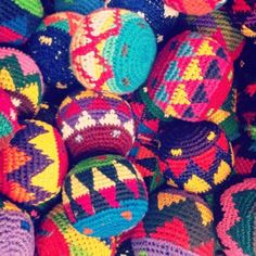 mexican hackey sacks! Would love to fill my teak wooden bowl with these. What great color:)
