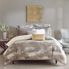 Graphix is a soft yet edgy design that incorporates hues of grey, sliver, and white on 100% poly jacquard. The set comes with two grey coordinating shams and two matching euro shams. The three decorative pillows are sophisticated and features one metallic print pillow, an oblong faux fur pillow, and a faux leather sequin pillow. The comforter comes with a removable insert and decorative buttons for a secured fasten.