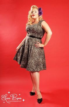 "Heidi Dress in Leopard by Pinup Couture - Plus Sizes - Our ""Heidi is the cute sister dress of our Natasha dress. Perfect for any season, this mini swing pinup dress combines the 1950's pinup with a modern twist with the shorter hem swing skirt. This dress features black sateen trim along the angular neckline, and sleeves. This dress also comes with a matching black sateen 1 inch slide belt, and a 23 inch zipper to allow the smoothest fit. The Heidi pinup dress is made from the highest…"