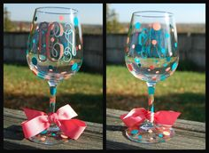 Great Gift Idea -  Monogram Wine Glasses - Decorated in vinyl with ribbon accent via Etsy.