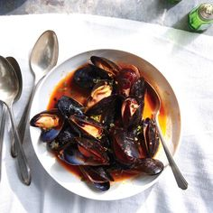 Spoon some aioli on a piece of toast, dunk it in the broth, and eat it along with the mussels. Repeat.