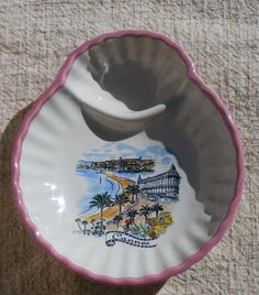 Cannes Souvenir Shell Dish.   A pretty little dish with a scene of Cannes. Pinkish mauve trim.