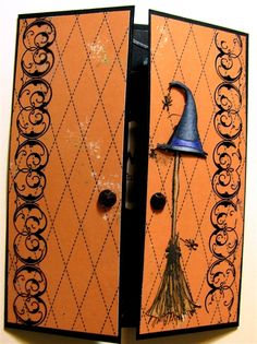 A homemade orange Halloween card shaped like a wardrobe featured with button-made handles, broomstick and a witch hat. Wonderful! / Lovely homemade Halloween cards / Amy Lopez on Fuseink