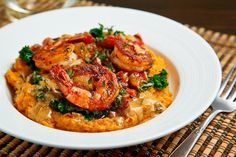 Blackened Shrimp on Kale and Mashed Sweet Potatoes with Andouille Cream. Make sure your seasonings are gluten free!