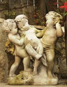 Sweet Franciscan Cherubs..would be perfect in my future all-white garden..