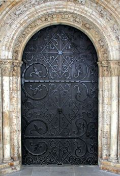 Church doors with intricate ironwork ... would be an amazing front door!