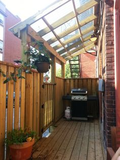 I like the way they've put a roof onto this lean-to/pergola. Looks good.