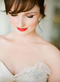 Red lips on a bride is seriously divine. What a beautiful portrait. by Jemma Keech