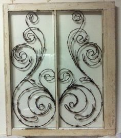 This custom window features an original antique frame and is titled Peacock . This design is hand crafted piece by piece with aged barb wire in a 28 x 32 double pane window frame. A beautiful design with flourish and character. This window is also available in any color and/or with antique finish. Custom sizes available as well. Glass is optional, and If the glass happens to break, your design is not going anywhere! I can give it and antique rustic or crackle look, color of your choice. What...