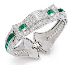 An Art Deco Emerald, Diamond and Platinum Bangle Bracelet, Oscar Heyman, circa 1930