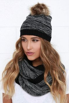 """The Cozy Coupling Black Scarf and Hat Set teams up to keep you toasty and stylish no matter how low the temps drop! Black and white marl knit shapes a wide infinity scarf that's the perfect length to wrap comfortably around your neck two times for a snug fit. A matching knit beanie is topped by a brown faux fur pompom. Beanie measures 9"""" tall and 14"""" opening (relaxed). Scarf measures 13"""" wide with a 56"""" circumference. 100% Acrylic. Dry Clean Only. Imported."""