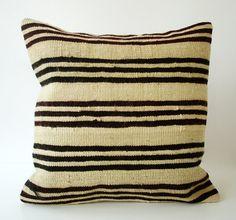 Turkish kilim cushion cover - I like a couple.  I am thinking burlap like mtrl and permanent marker stencil stripe