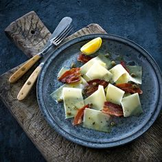 Have you ever tried cheese carpaccio? TryCastello Creamy Havarti with bacon and capers.