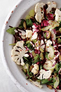 This shaved cauliflower and radicchio salad boasts golden raisins, toasted pistachios, and tangy Aleppo pepper.