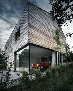 Love this garage! Perfect for displaying Mark and I's future car collection. (TBONE House by Coast Office Architecture)