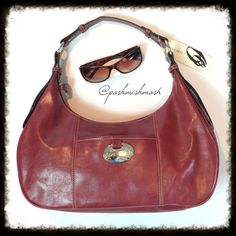 """NWT Brick Red Nine West Purse Brick red shoulder bag from Nine West has a top zipper closure. Interior has one zip pocket. Exterior has one slip pocket with a silver Nine West tag.  Approximately 15"""" by 7"""". Handle drop measures 11"""". It fits easily over the shoulder. Although it is new, there is a mark on the interior. Man made materials. Nine West Bags Shoulder Bags"""