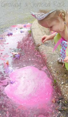 Magical rainy day puddle play with MAGIC bubbling puddles - SUPER FUN rainy day activity for kids that explores sensory play, art, science, imaginative play, and more!