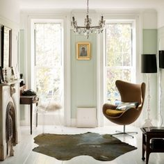 I love that mod 60's chair against that mint green wall color.