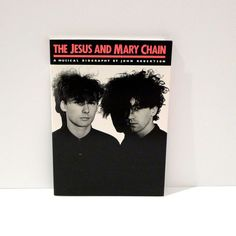 Vintage Jesus and Mary Chain paperback book --- Like New -- A Musical Biography by John Robertson  Book measures approximately 10 by 7 inches and is 96 pages. New, never used. Not shrink wrapped. Extremely minor shelf wear. The book was published in 1988 and has lots of great photographs and images.   USA Priority Mail shipping with insurance and tracking. We ship internationally.  We have been collecting vintage clothing and objects for years and owned two Mohawk Music record stores and are…