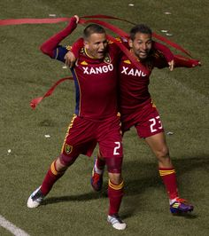 Luis Gil (21), left, celebrates his second half goal with teammate Real Salt Lake's Paulo Junior (23).